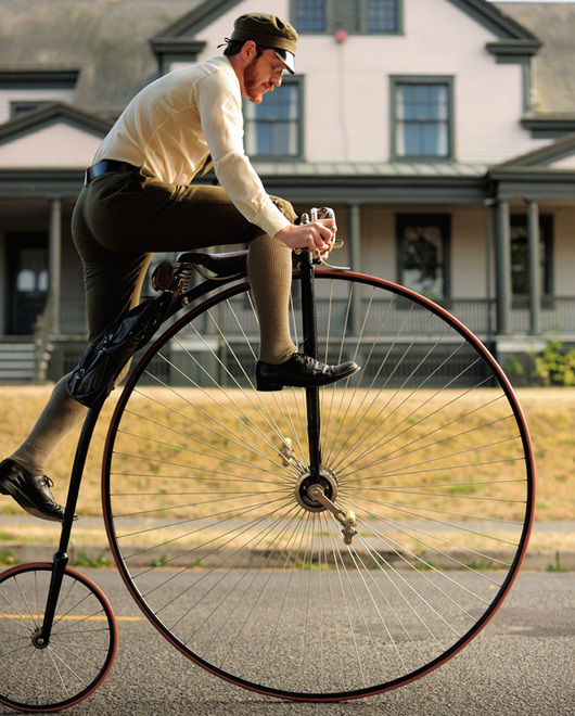 Gabriel mounts his high-wheel bicycle. (Photo courtesy Estar Hyo-Gyung Choi, Mary Studio, via ThisVictorianLife.com)
