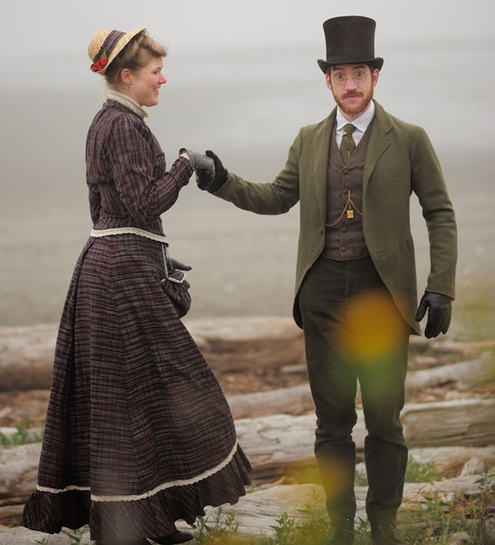 Sarah wears an 1880s style dress in a reproduction of a popular 1880s plaid. Gabriel's pants and waistcoat were copied from an 1870s suit while his cutaway coat was copied from an 1889 original. He wears an antique beaver-felt top hat. (Photo courtesy Estar Hyo-Gyung Choi, Mary Studio, via ThisVictorianLife.com)
