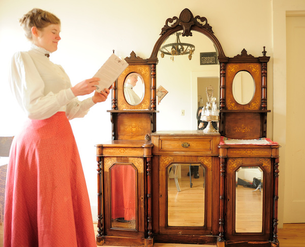 Sarah reads in her dining room, in front of her china hutch from 1860s Austria. (Photo courtesy Estar Hyo-Gyung Choi, Mary Studio, via ThisVictorianLife.com)