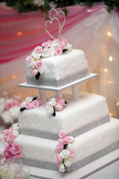Pictures of Square Wedding Cakes   LoveToKnow Square wedding cake with pedestals between layers