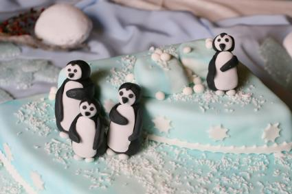 Ideas for January Weddings A penguin themed cake is perfect for a whimsical January wedding