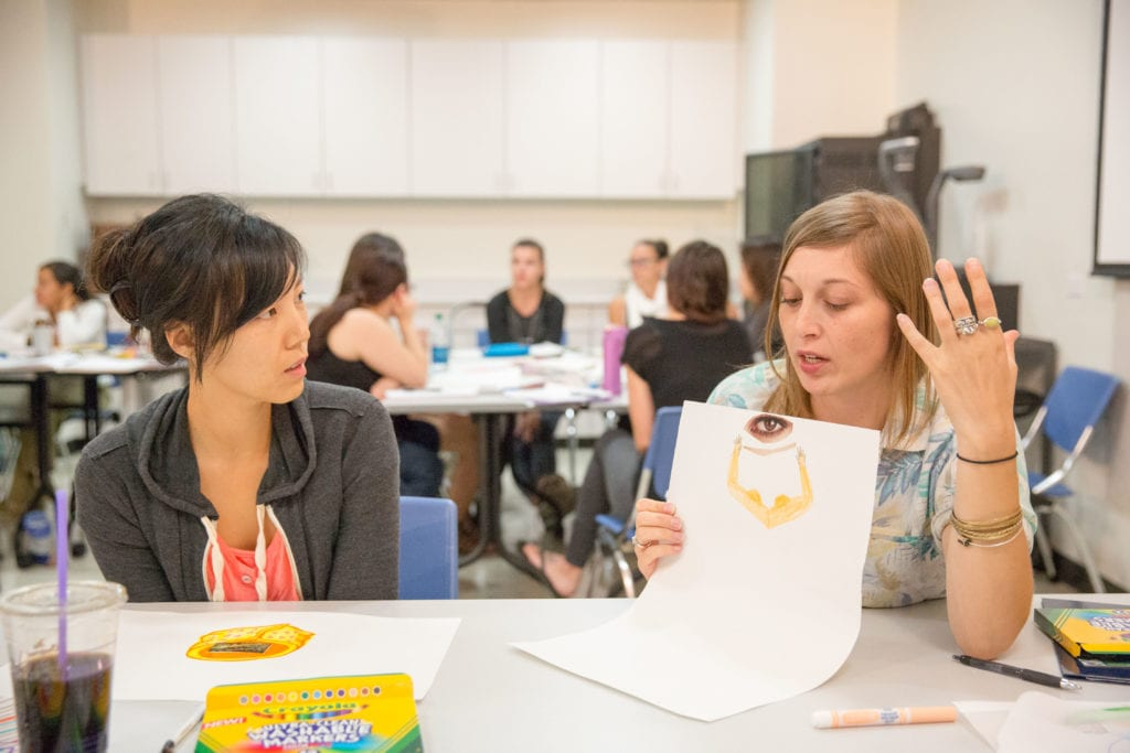 Art students discussing their projects