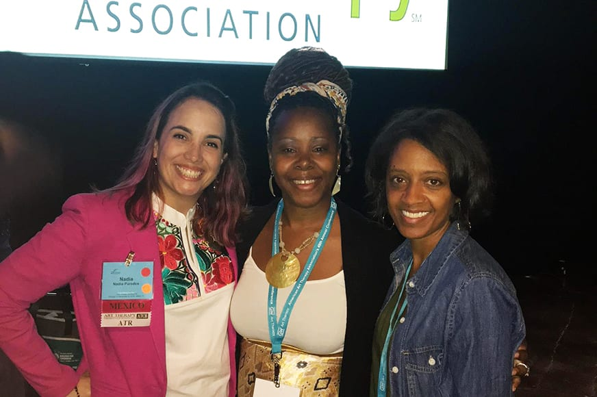 Nadia Paredes, Louvenia Jackson, and Genia Young smiling