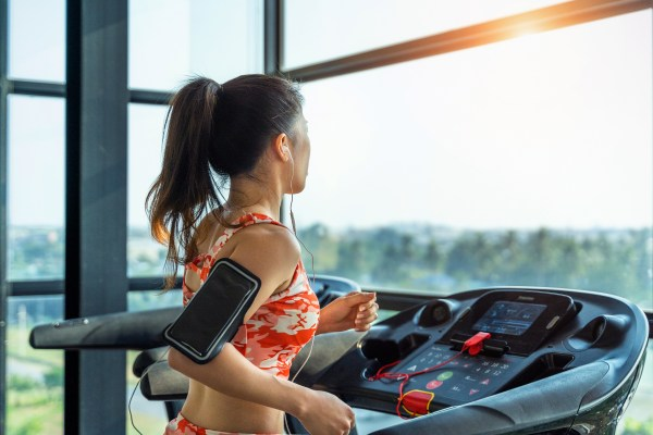 Young woman exercise with exercise-machine in gym.