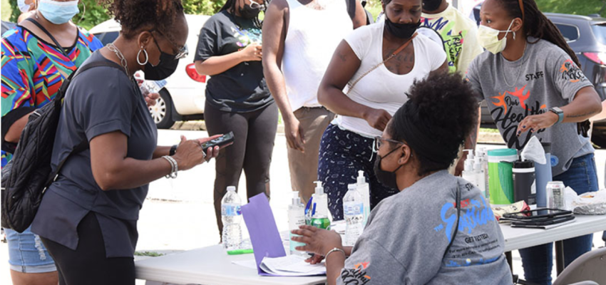 Neighbors line up at a community hosted vaccine event on Kansas City's east side
