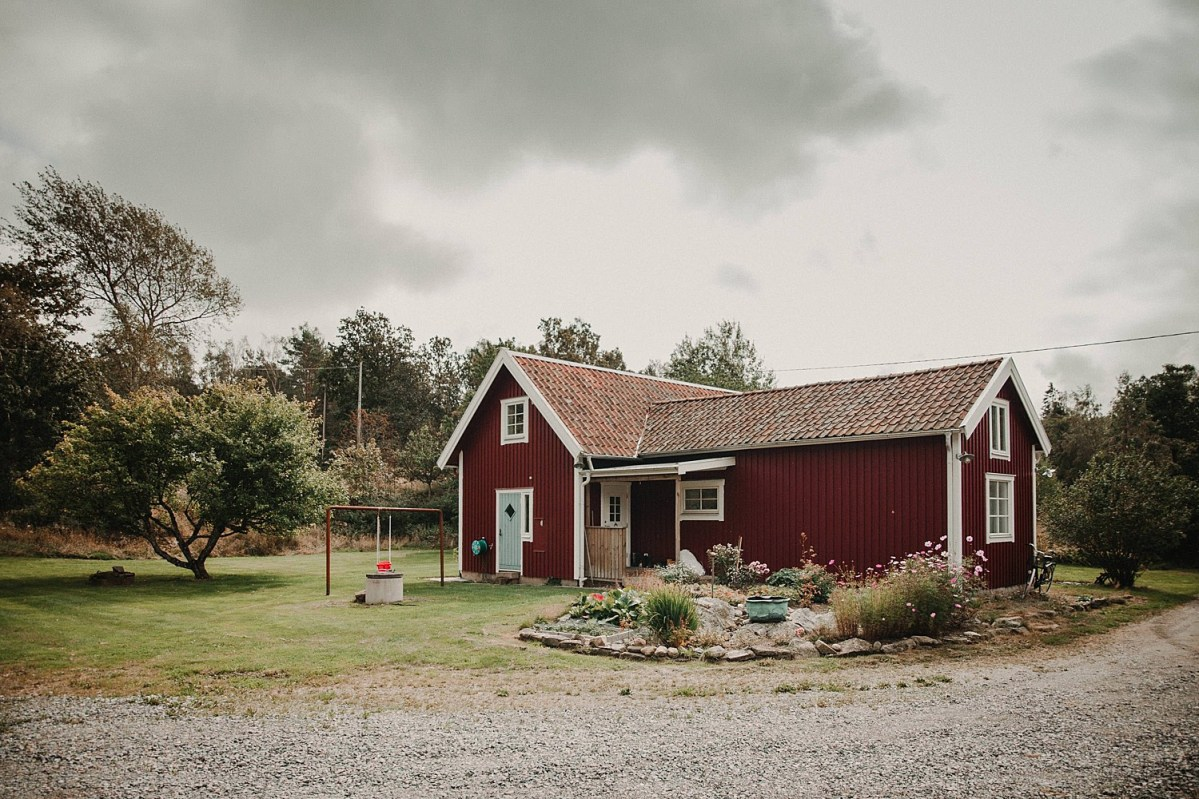 small red cottage in the countryside