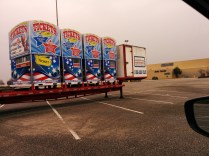 The carnival crew prepares to unload ticket signs from a trailer parked outside Sears on Regency Square's west side.