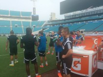 Fulham players pause to cool off during a hot practice session at EverBank Field.