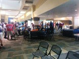 It's busy! Players and coaches from dozens of area schools swarm around the east side of EverBank Field's club section.