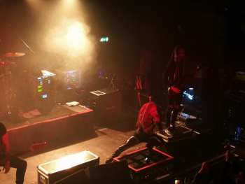 Infected Rain's Lena Crouched Onstage At The Garage Glasgow
