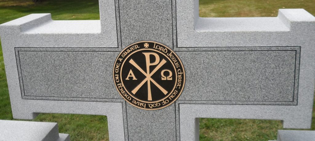 Religious Symbol on a Headstone Cross