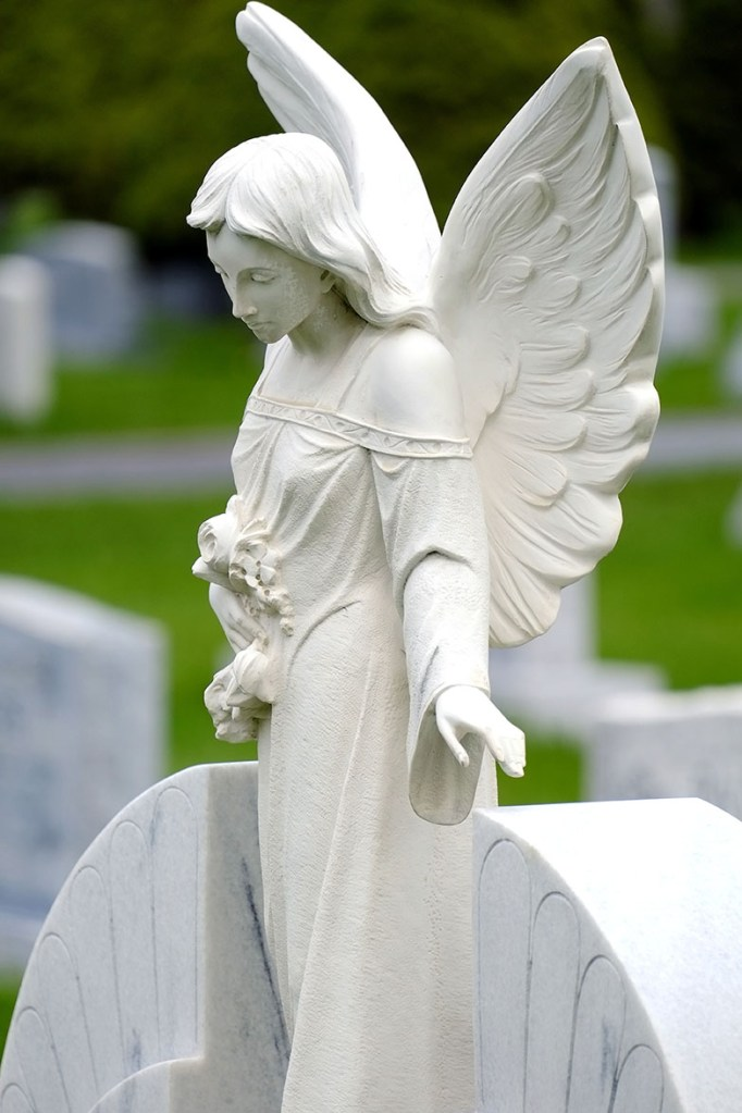 Carved angel from granite headstone
