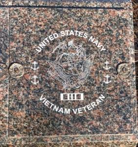 Laser engraved cremation niche cover done on Dakota Mahogany granite.