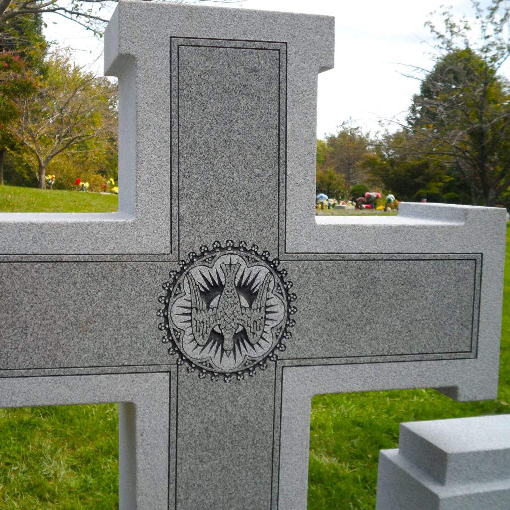 Back of Georgia Gray Granite cross with engraved dove