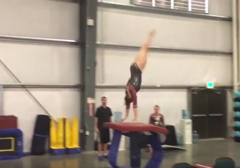 Showing angle of repulsion in near perfect front handspring vault