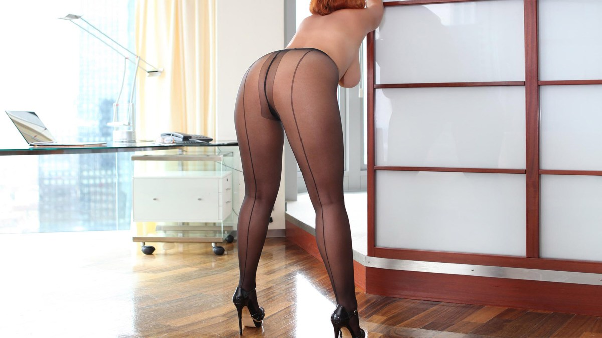 Sofia BBW and independent escort with huge butt in nylons and high heels topless leaning forward from behind