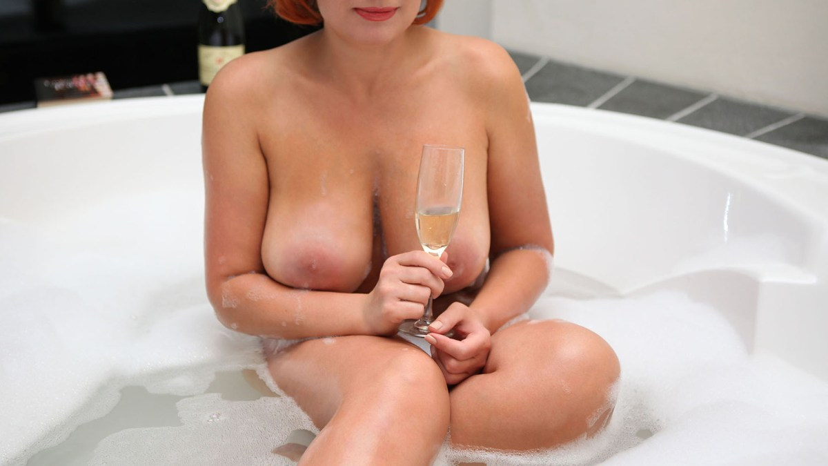 Sofia graduate engineer and German BBW naked with big tits in the bath with a glass of champagne