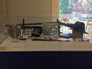 Civil War sword and hat in a display case