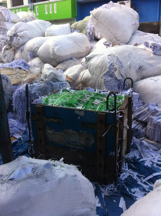 Shredded paper being baled before being transported