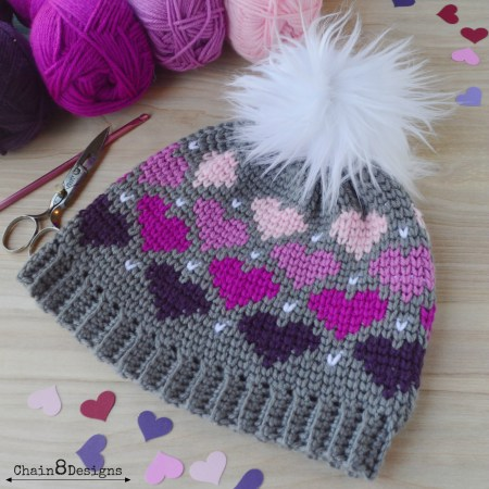 Twitterpated Heart Beanie | FREE Women's Crochet Hat Pattern. | This cute hat pattern is full of love and perfect for Valentine's Day. Easy to follow tutorial with lots of photo's. Make one for the loves in your life today!