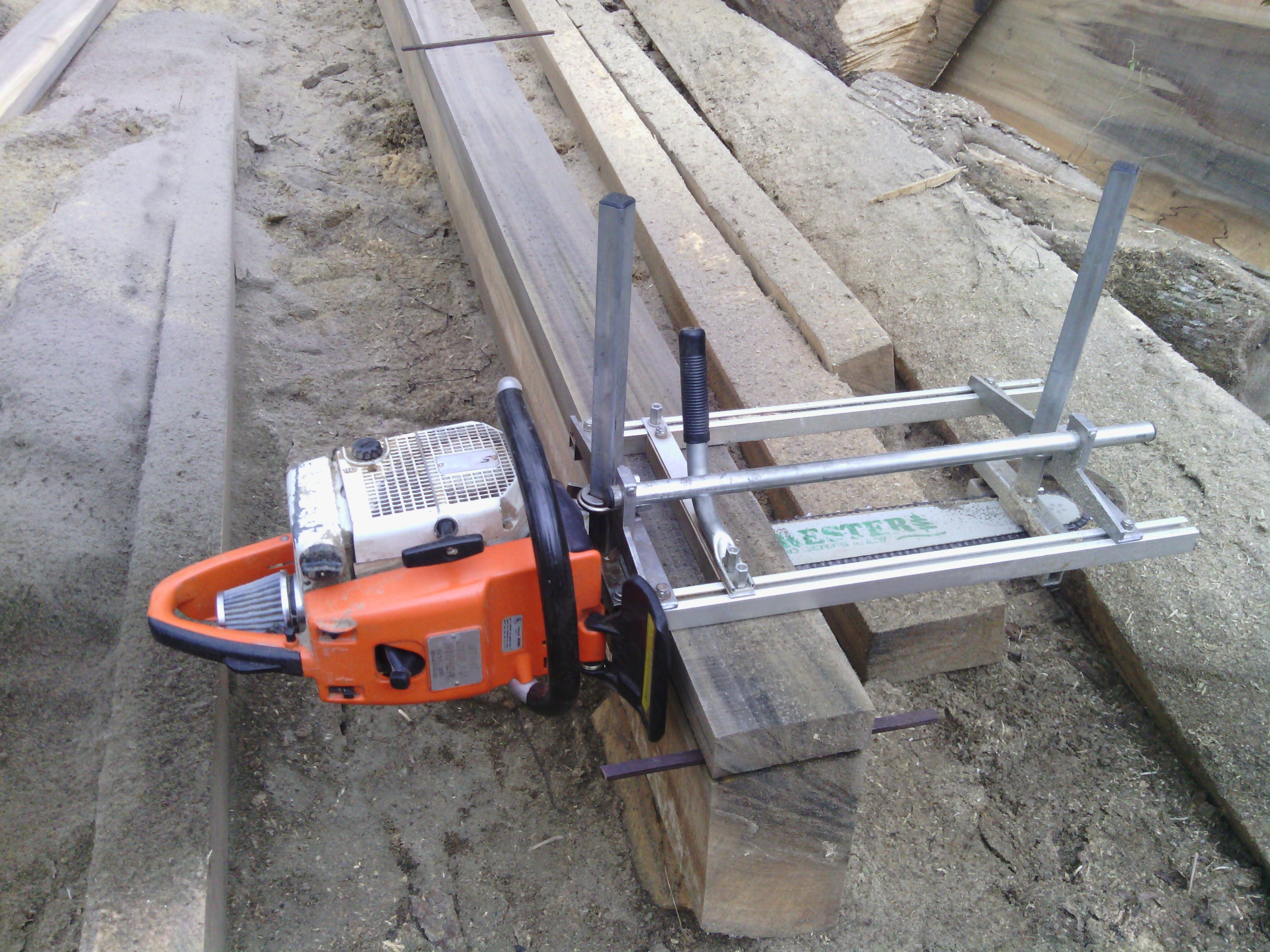 What are some common attachments and accessories for a chainsaw?