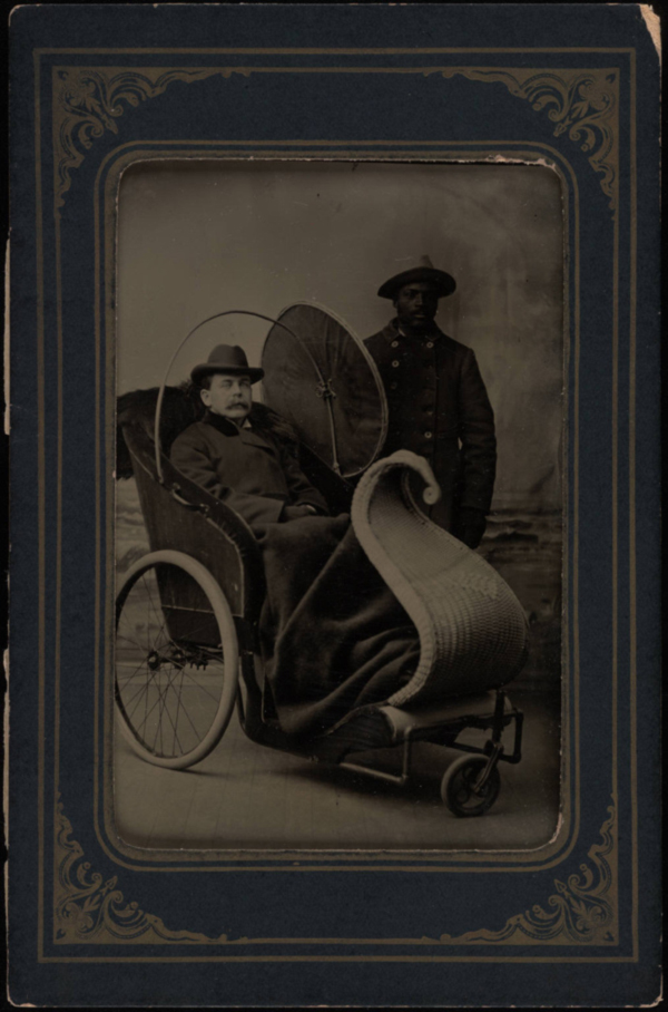 gentleman-seated-in-wicker-boardwalk-wheeled-chair
