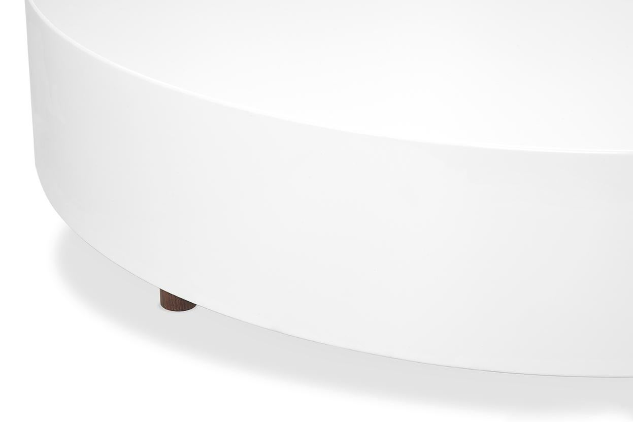 drop round coffee table w wood legs and white lacquer