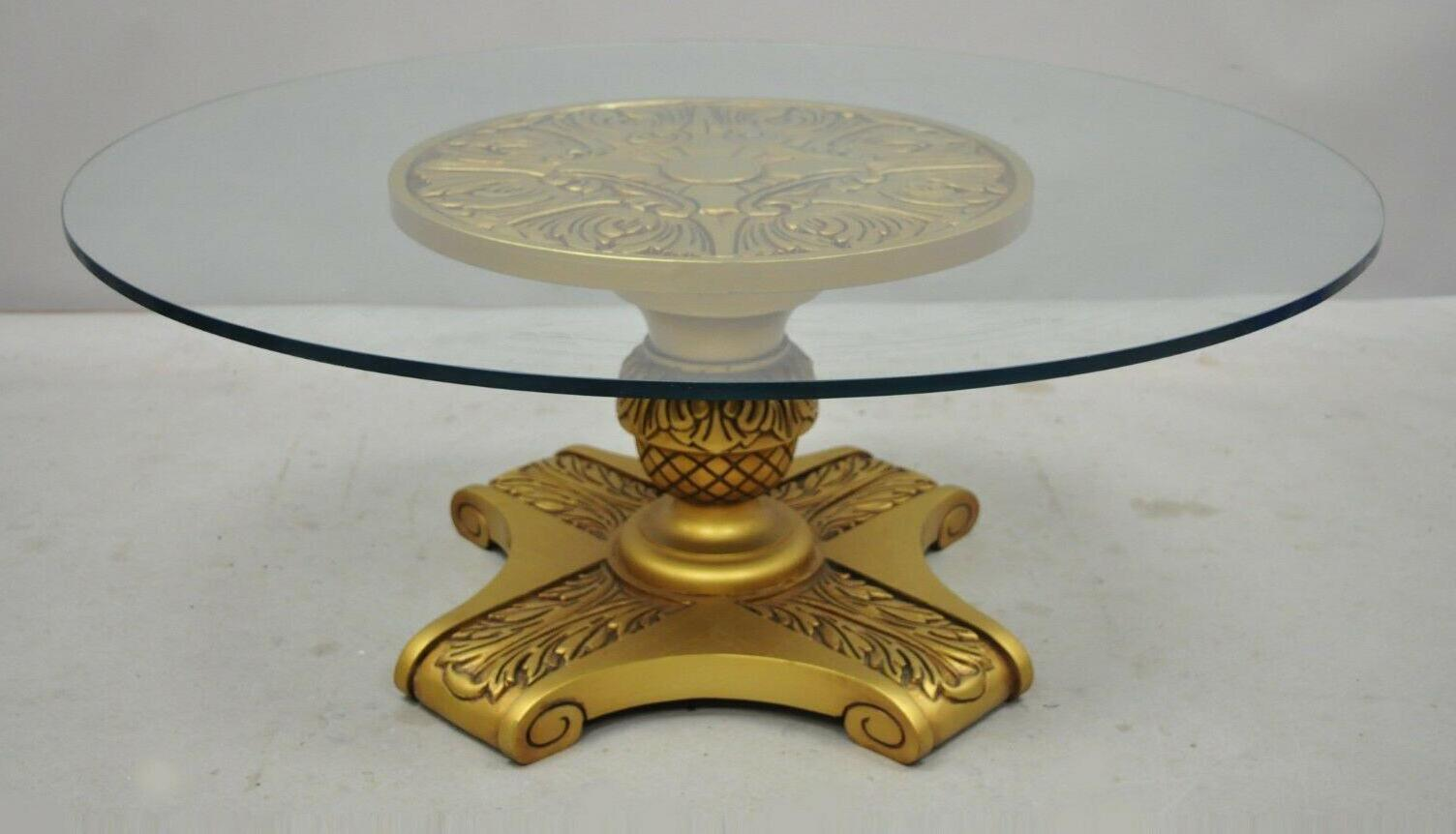 hollywood regency gold pedestal base glass top coffee table