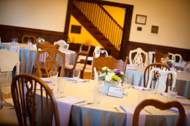 Mismatched vintage chairs at Louvier Village Clubhouse, photographed by Honeytree Designs