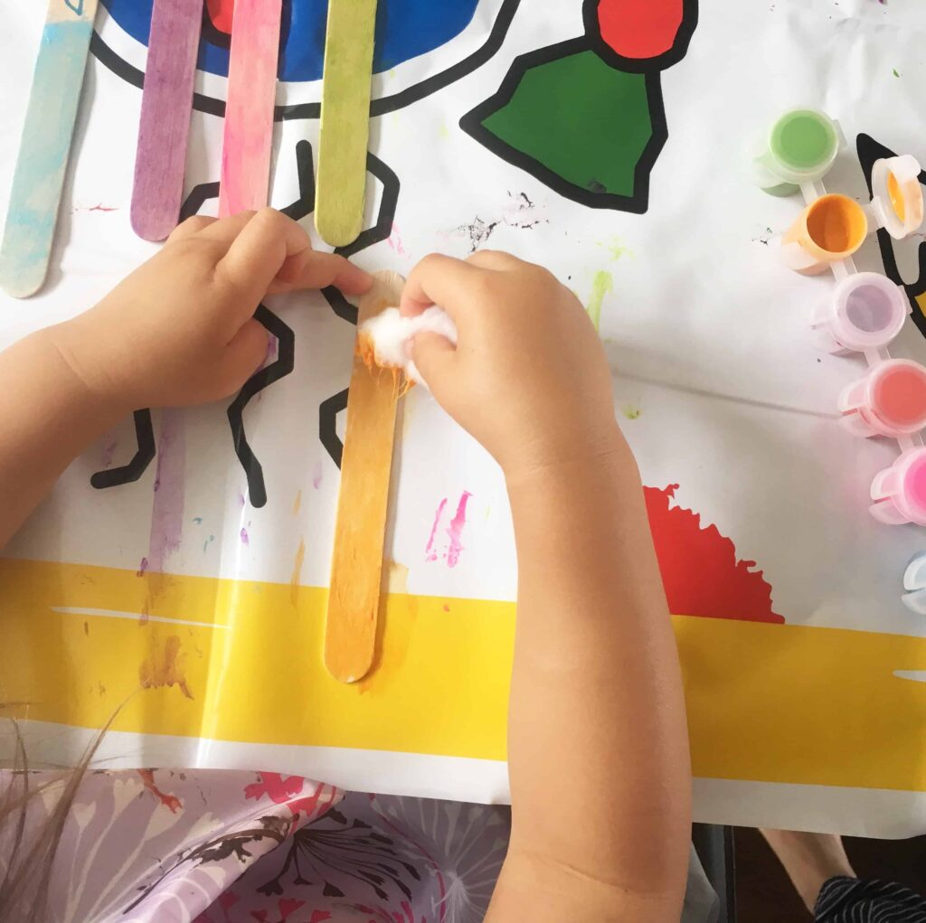 painting craft sticks with cotton balls