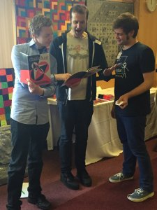 James Grime, Matt Parker and Matthew Scroggs enjoying Chalkdust.