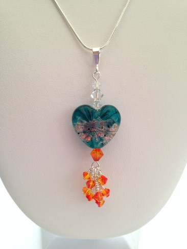 Ice and Fire pendant made with a Starburst lampwork heart, Swarovski crystals and Sterling silver.