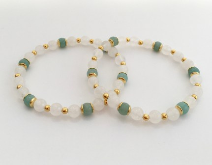 Amazonite and white Jade bracelets with gold accents.