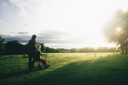 caregiver watching sunset with client