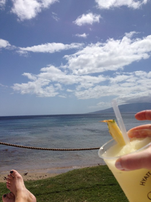 Eileen Callahan of Champagne Travels luxury travel writer in Hawaii enjoying tropical cocktails