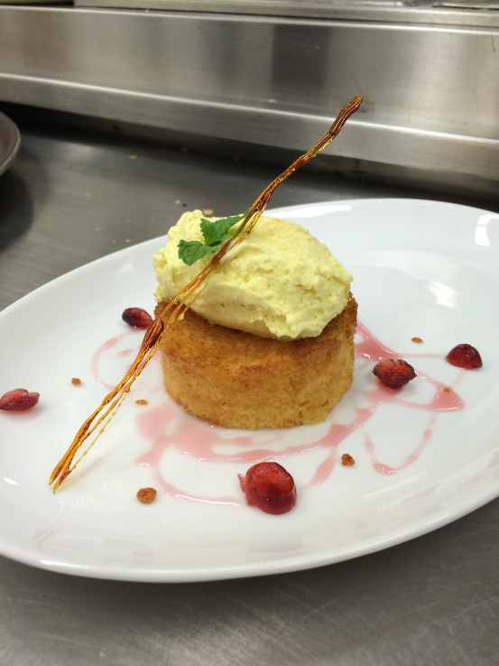 My student special: curry white chocolate ice cream with honey sponge cake and cranberry reduction