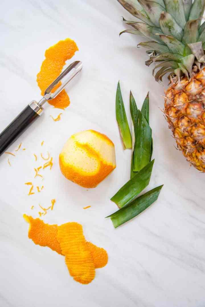 Island-Inspired Edible Cocktail Garnish: Pineapple Leaves + Citrus Peel