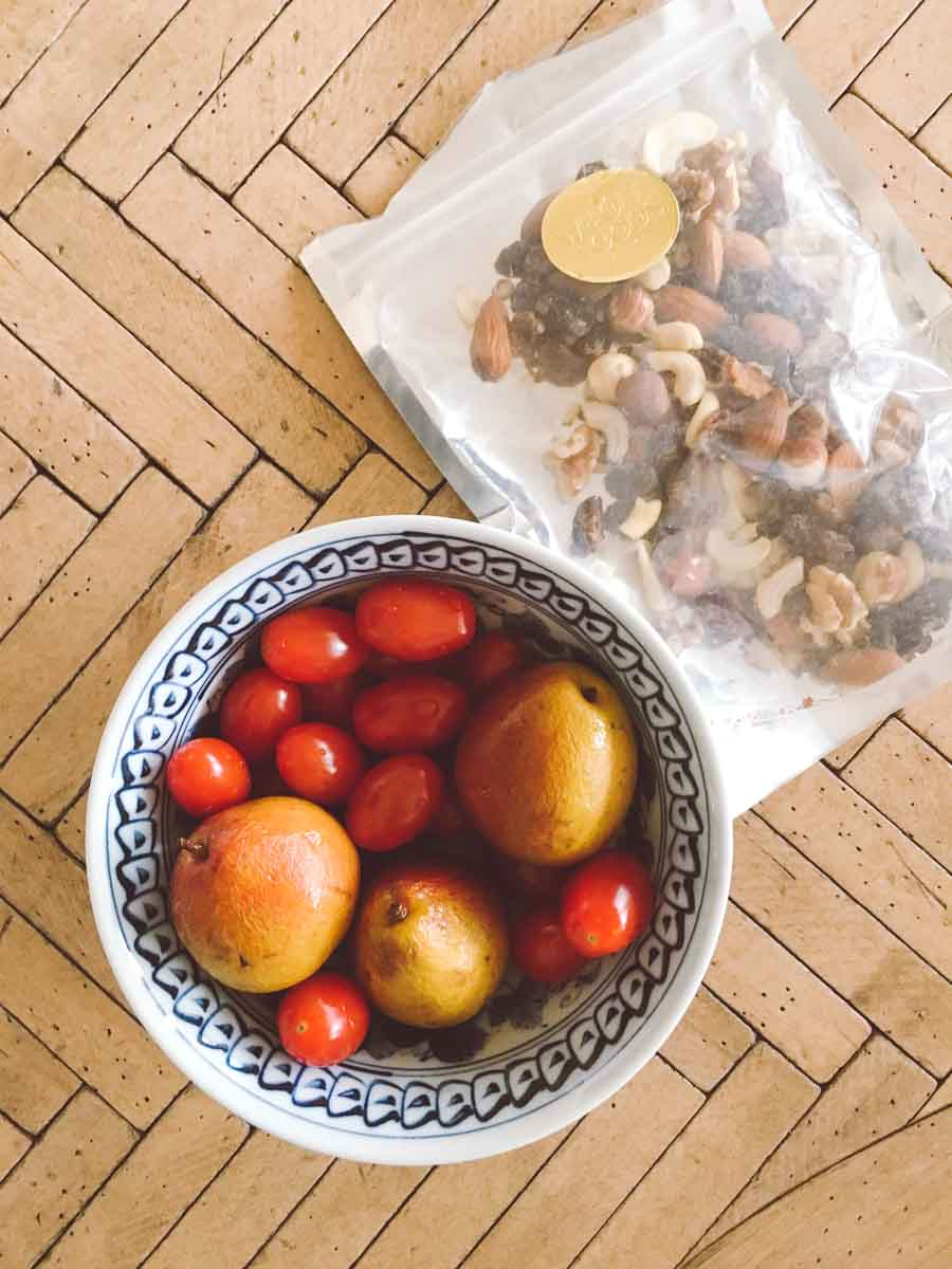 What a dietitian eats in a week - Trail mix, tomatoes, and mini pears in a bowl