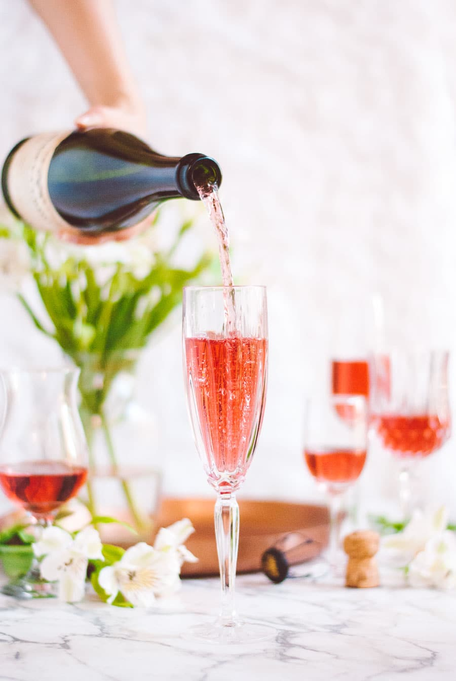 a bottle of Bugey-Cerdon La Cueille French sparkling wine bring poured into a flute