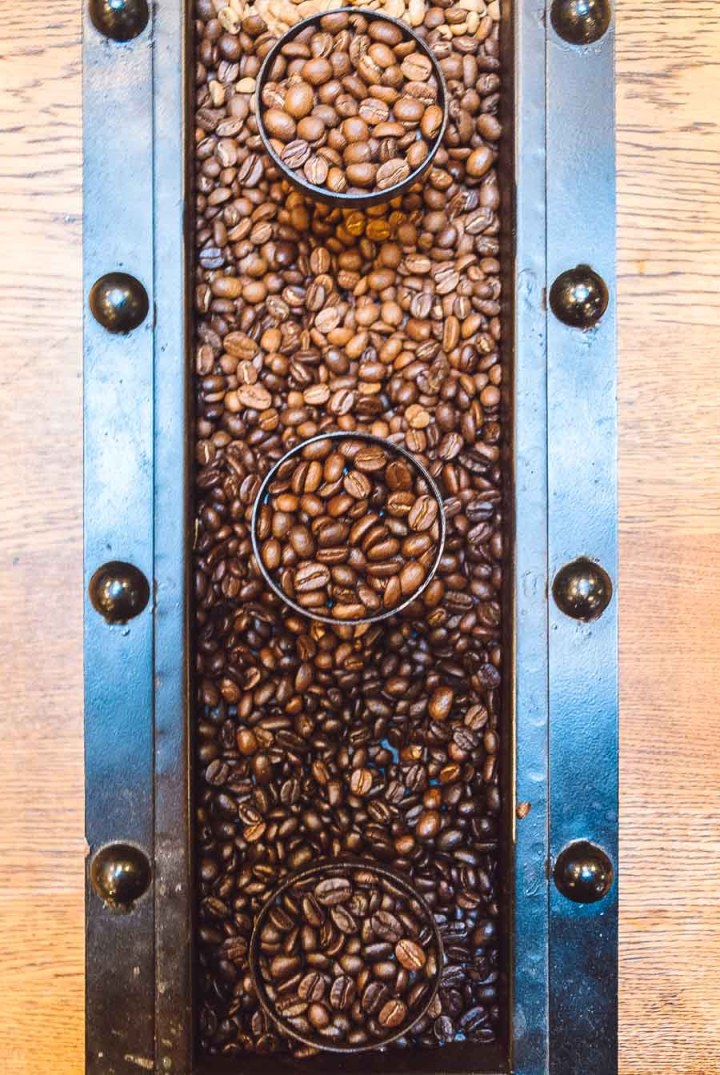 Overhead shot of a roasted coffee bean display with varying colors of roasted coffee beans.