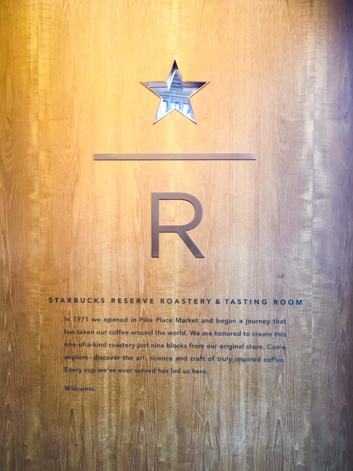 Wood wall with the Starbucks Reserve Roastery and Tasting room logo