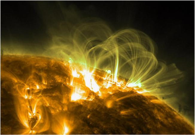 Coils of magnetic field lines. The bundles of coils are charged particles swirling along magnetic field lines. Image: NASA Solar Dynamics Observatory (SDO)