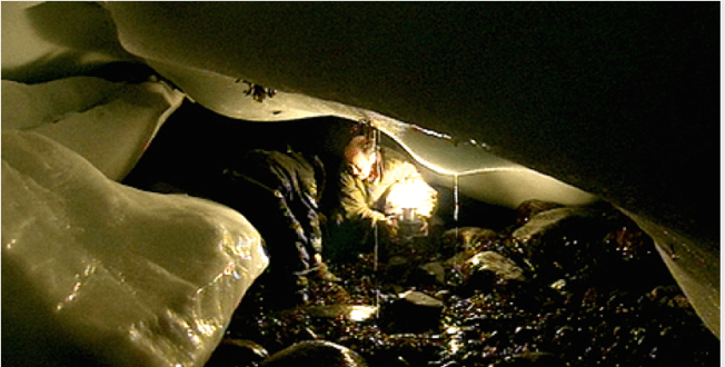 Gathering mussels Under The Ice, hastening before the sea returns. Source: Context Film