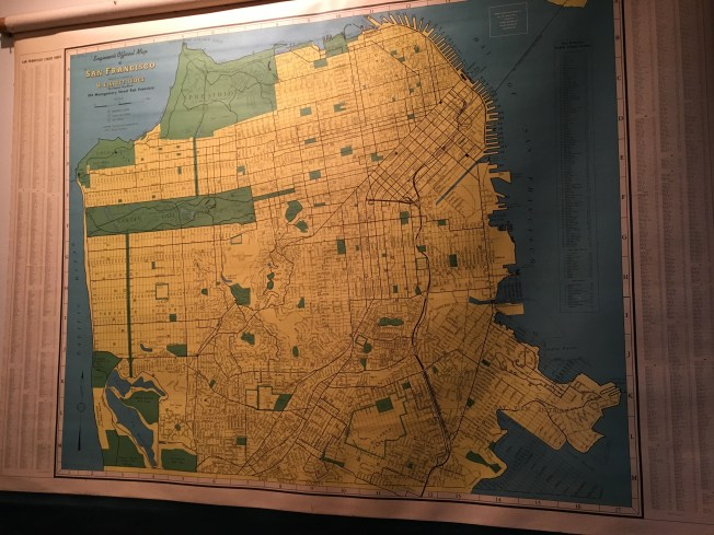 A map of San Francisco, circa 1950, hung on a friend's wall. The Presidio is the entire green area at the top of the map. Source: W. Elliot Judge