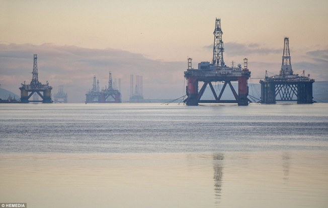 The Cromarty Firth, north of Inverness, is currently packed with more unused rigs than it has been at any point in the last decade Read more: http://www.dailymail.co.uk/news/article-3410415/The-oil-rig-graveyard-dozen-thousand-tonne-structures-parked-unused-Scottish-firth-market-swamped-cheap-crude-demand-drilling-drops.html#ixzz4GrmKAQVN Follow us: @MailOnline on Twitter   DailyMail on Facebook