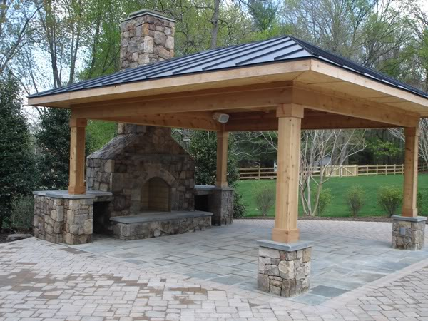 outdoor covered patio with fireplace and kitchen Outdoor Kitchens and Patios   Champion Property Improvement