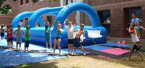 Enjoying our 50-foot, two-lane slip and slide on a hot day!