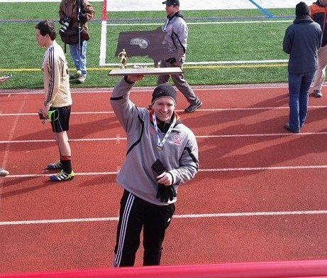 Coach Charles Goodhue hoists the D3 State Championship Trophy