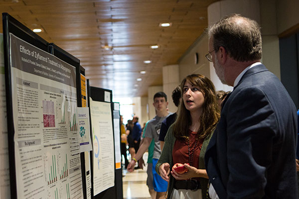 Student explaining research at EUReCA during Undergraduate Research Week