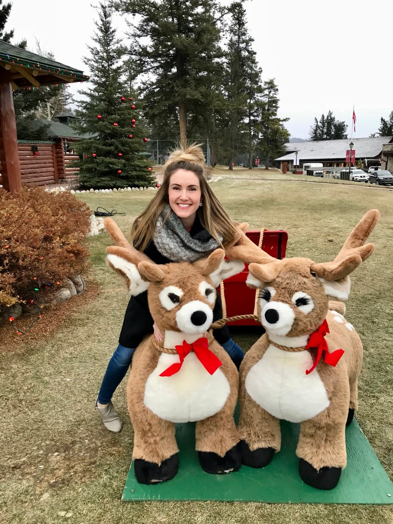 A sleigh of reindeer outside the man cabin at Christmas in November at Fairmont Jasper Park Lodge